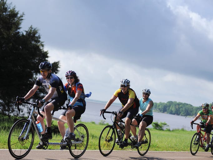 Pairs of riders make their way north along the Natchez-Trace