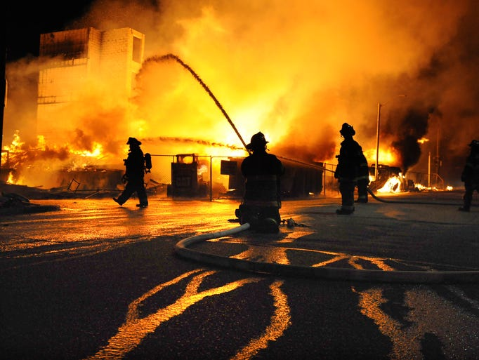 Baltimore firefighters battle a three-alarm fire at