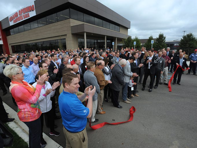 Company and local officials celebrate the grand opening