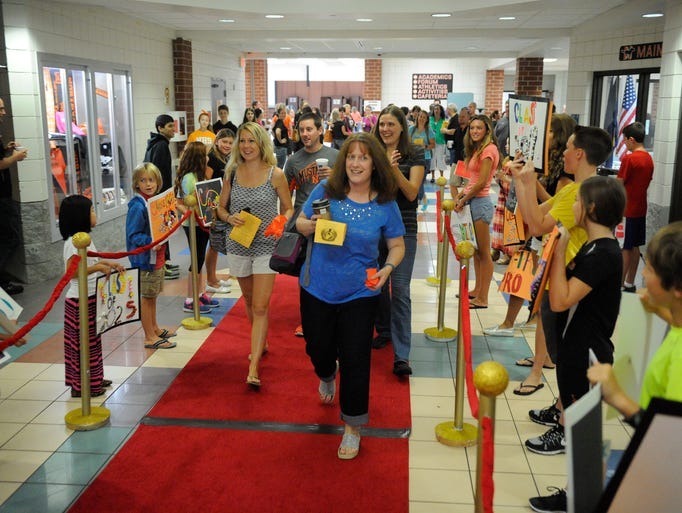 Northville teachers walking down the red carpet at