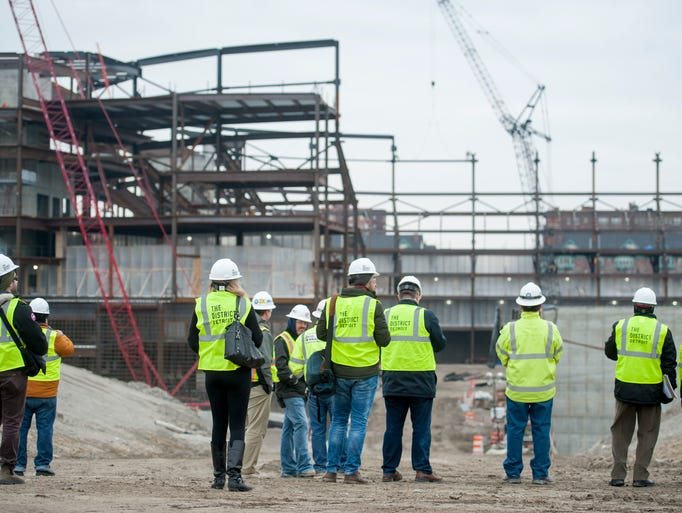 Members of the media are given a tour of the construction