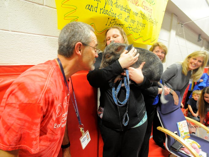 "Science/media specialist Terry Schneider kisses ""Dillon,"""