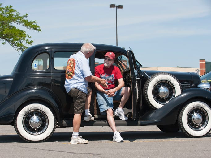 Retired Eastpointe mayor Harvey Curley, left, chats
