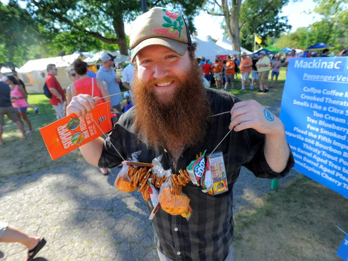 Joe Gassel, of Ypsilanti, holds up the snack necklace