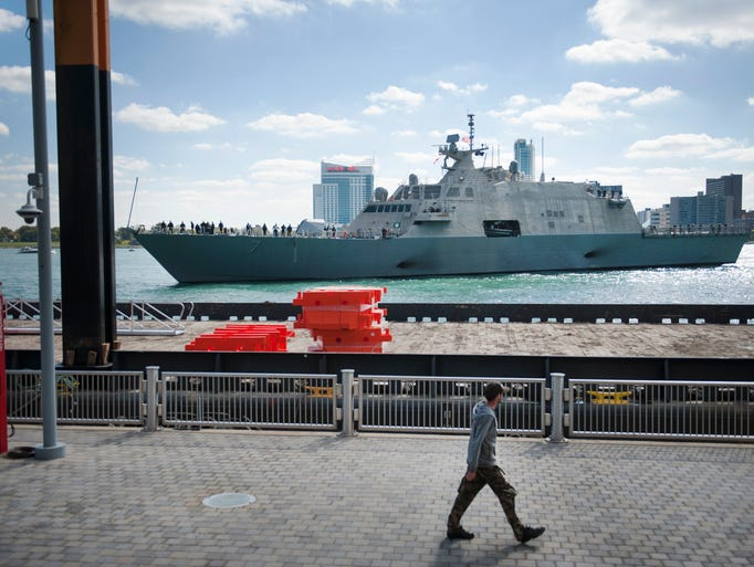 The USS Detroit arrives at the Detroit Riverfront