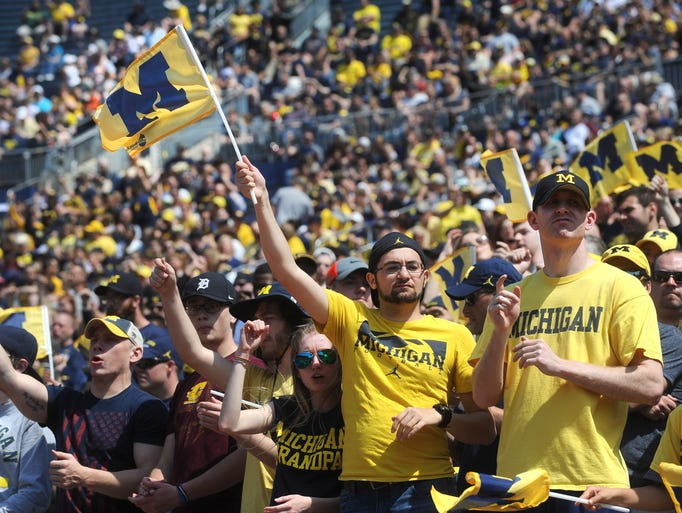 University of Michigan fans cheer during the Spring