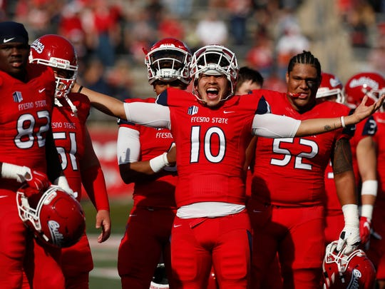 Fresno State Bulldogs quarterback Jorge Reyna cheers on teammates during Senior Day before the start of the game against the Boise State Broncos at Bulldog Stadium.