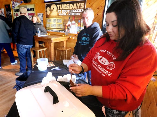 Holly Semrad portions a sampling of chili created at Bootleggerz during the ninth annual Oconomowoc Chili Fest. The 10th annual event is scheduled for Saturday, Jan. 26, 2019.