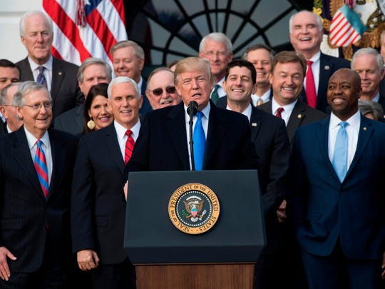 US President Donald Trump flanked by Republican lawmakers