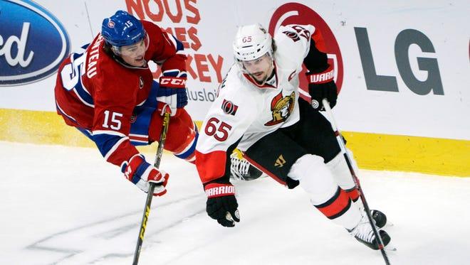 Montreal Canadiens forward Pierre-Alexandre Parenteau (15) chases Ottawa Senators defenseman Erik Karlsson (65) during a game earlier this season.