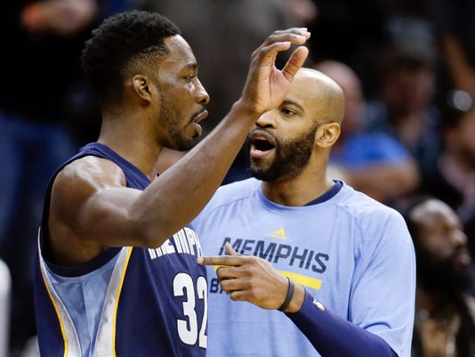 FILE - In this Jan. 16, 2015, file photo, Memphis Grizzlies' Vince Carter, right, talks with Jeff Green (32) during a timeout in the second half of an NBA basketball game against the Orlando Magic in Orlando, Fla. The Memphis Grizzlies are in a bit of a chemistry experiment right now. They hope their newest teammate Jeff Green can help them go further than ever in the postseason, and they're busy figuring out exactly where he works best.  (AP Photo/John Raoux, File)