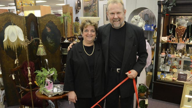 Linda and Bruce McKenzie recently celebrated their 20th year of managing Northville Township's Knightsbridge Antique Mall. The mall is located on Seven Mile Road, west of Northville Road. With them is their dog Roxanne.