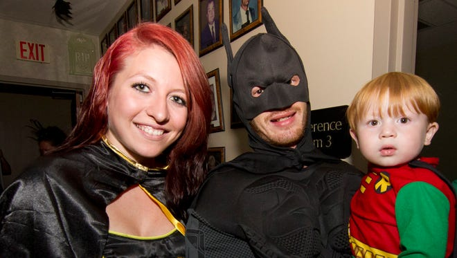 Elizabeth and Joe Swain dressed in Batwoman  and Batman costumes with son Hunter (2) as Robin at the Hendersonville, TN city Hall on Fri. Oct 30, 2015.