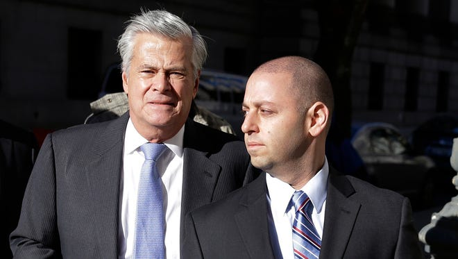 New York Sen. Dean Skelos, left, and his son. Adam, arrive to court on Nov. 17.