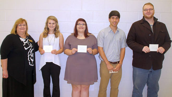 Terri Ruckel presented the Pearl River Community College Forrest County Center creative writing awards to, from left, Samantha Jackson of Neely, first; Kacey Toney of Purvis, second; Nathan Claret and Alex B. Doyle, both of Hattiesburg, third. They received the awards during a May 2 ceremony.