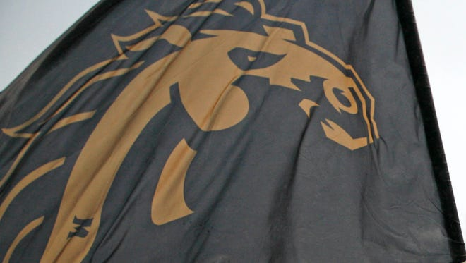 The Western Michigan Broncos flag is waved during a November game in 2015.