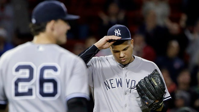 New York Yankees relief pitcher Dellin Betances, right, pauses on the mound with first baseman Tyler Austin during the ninth inning of a baseball game against the Boston Red Sox at Fenway Park, Thursday, Sept. 15, 2016, in Boston. Red Sox's Hanley Ramirez hit a three-run walk-off home run to give the Red Sox a 7-5 win.