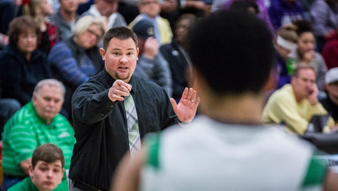 Yorktown's Eric Branz coaches against Central at Yorktown High School Saturday, Nov. 25, 2017.