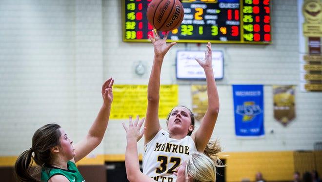 Monroe Central's Abigail McGrath shoots past Yorktown's defense during their game at Monroe Central High School Thursday, Dec. 7, 2017.