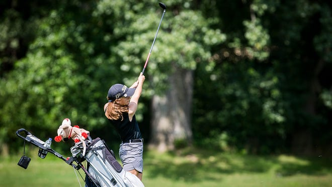 Daleville's Willoe Cunnington hits during the girls county golf tournament at Muncie Elks Saturday Aug. 11, 2018.