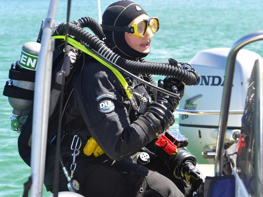 Caitlin Zant, maritime archeologist with the Wisconsin Historical Society, prepares to dive on Lake Michigan shipwreck near Two Rivers.
