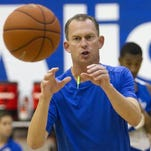 FGCU's head coach Joe Dooley calls a play against North Florida on Saturday at Alico Arena in Fort Myers.