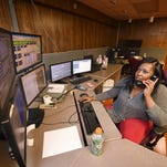 Danielle Eubanks, a dispatcher with the Hinds County Sheriff's Department, takes a call at her post in the county's Emergency Operations Center in Jackson on Tuesday.