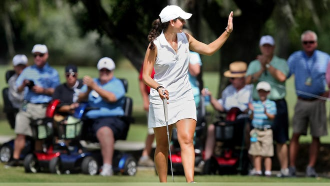 Emma Talley waves to the gallery after a putt on No. 4 at the U.S. Women's Amateur on Saturday.