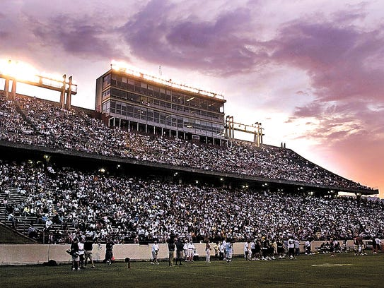 The sun sets over Cajun Field during a 2003 New Orleans Saints scrimmage. The press box side of the UL football team's stadium looks much now like it did then, but plans for major renovation are being studied.