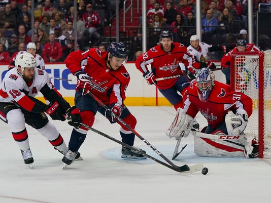 Ottawa Senators left wing Zack Smith (15) has his shot blocked by Washington Capitals defenseman Dmitry Orlov (9) as Capitals goaltender Philipp Grubauer (31) watches during the first period of an NHL hockey game Tuesday, Feb. 27, 2018, in Washington. (AP Photo/Pablo Martinez Monsivais)