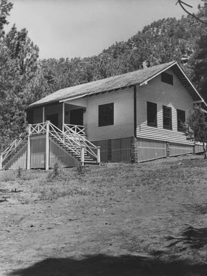 A 1964 photo shows Zane Grey's Cabin before it was destroyed in the 1990 Dude Fire.