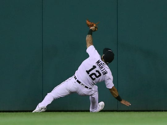 Tigers center fielder Leonys Martin catches a fly ball against the Athletics in the seventh inning Wednesday.