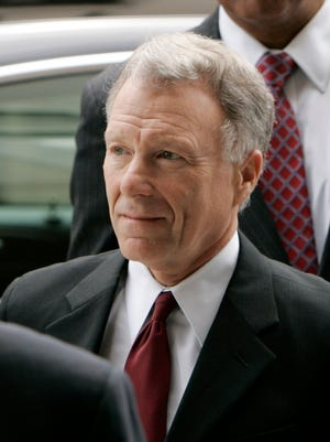 Former White House aide I. Lewis 'Scooter' Libby, arrives for a federal court hearing in Washington in 2007.