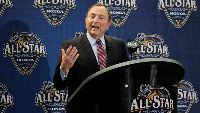 NHL Commissioner Gary Bettman answers a question during a news conference before the NHL All-Star skills competition.