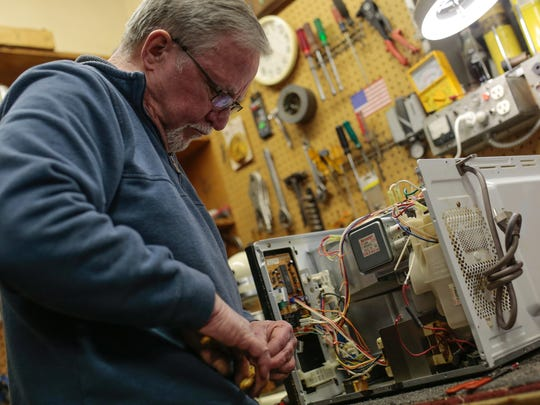 McNichols Electric co-owner Dave Kehoe works on fixing