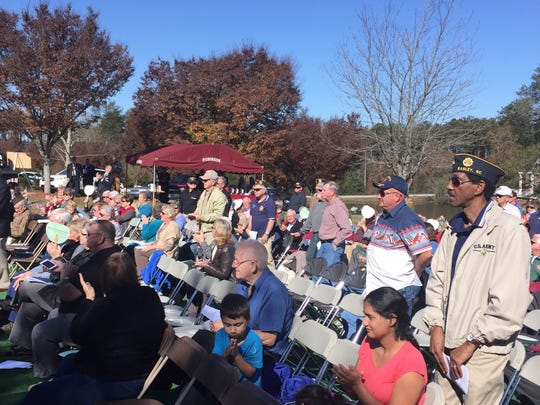 Vietnam veterans stand to be recognized during a Veterans Day ceremony in Easley.