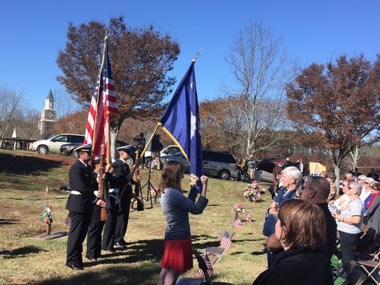 Post of the colors by the Easley High School Navy JROTC during a Veteran's Day ceremony at Robinson Memorial Gardens in Easley