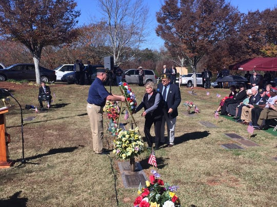 Ann Bayne, sister of Vietnam veteran Lonnie Dalton, who died during the past year, lays a wreath during Veterans Day ceremonies in Easley.