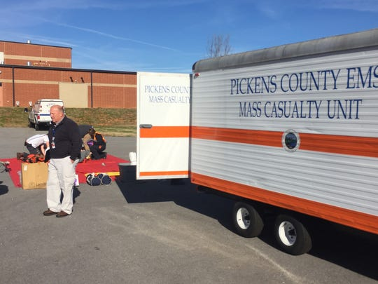 Pickens County EMS personnel prepare to transport a