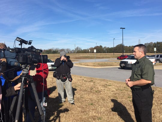 Pickens County Sheriff Rick Clark talks to the media