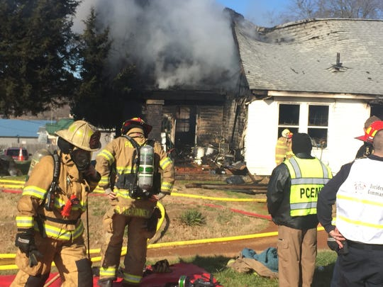 Pickens firefighters on the scene of a house fire on Ann Street on Tuesday.