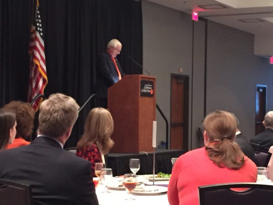 Clemson Mayor J.C. Cook addresses members of the Clemson Area Chamber of Commerce at the annual State of Clemson luncheon Tuesday.