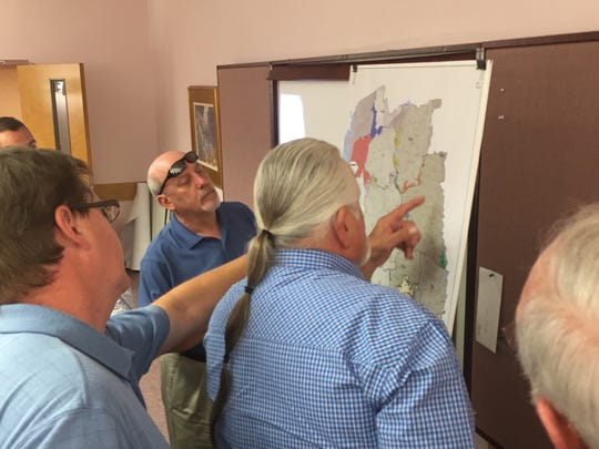 Members of Pickens County Council study a map of county fire districts for possible boundary changes during a June 2015 meeting.