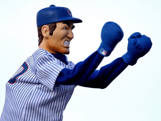 A vendor demonstrated the fighting skills of a baseball player hand puppet as the Iowa Cubs played Colorado Springs at Principal Park in Des Moines on Saturday night  June 7, 2014.