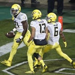 Oregon running back Royce Freeman (21) celebrates after running in a touchdown in the first half of an NCAA college football game against Colorado in Boulder, Colo., Saturday, Oct. 3, 2015.