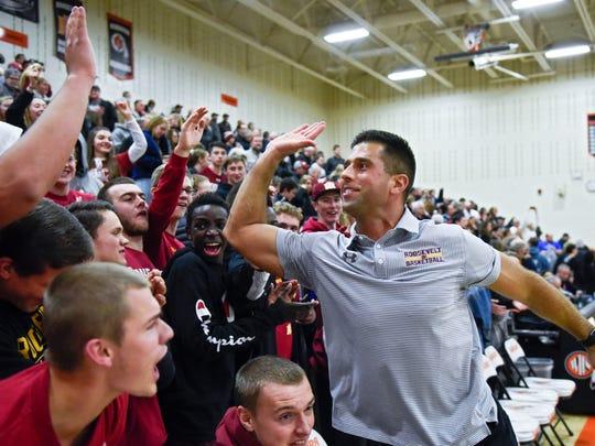 Roosevelt head coach Mitch Begeman high fives a member