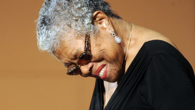 Angelou bows to accept applause as she is introduced. Maya Angelou spoke at Butler University's Clowes Hall to start off the school's annual Celebration of Diversity Distinguished Lecture Series Wednesday September 25, 2013.