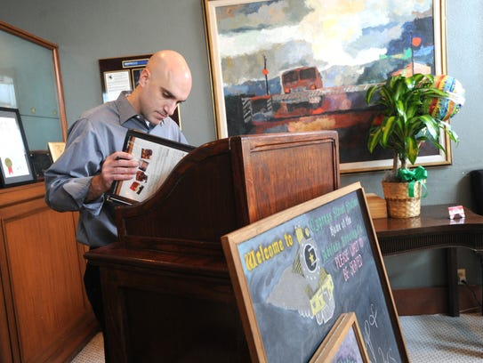 Terry O'Connor looks over a menu before Cypress Street