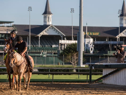 Justify is lead off the track by Jimmy Barnes