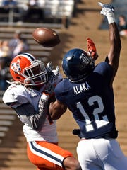 UTEP defensive back Kalon Beverly, left, breaks up a pass intended for Rice wide receiver Temi Alaka (12) during the first half of an NCAA college football game, Saturday, Nov. 19, 2016, in Houston.